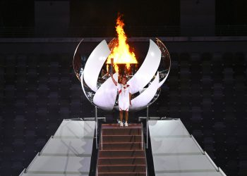 Tennis player Naomi Osaka concludes the lighting of the Olympic Cauldron during the opening ceremony in the Olympic Stadium at the 2020 Summer Olympics, Friday, July 23, 2021, in Tokyo, Japan. (Dylan Martinez/Pool Photo via AP)
