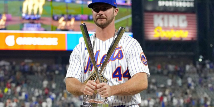 National League's Pete Alonso, of the New York Mets, holds the champions trophy after winning the MLB All Star baseball Home Run Derby, Monday, July 12, 2021, in Denver. (AP Photo/David Zalubowski)