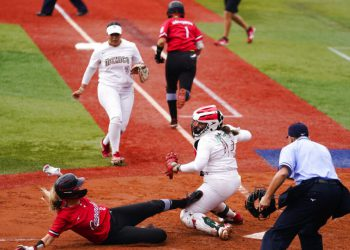 Canada's Victoria Hayward, left, is tag out by Mexico catcher Sashel Palacios during a softball game at the 2020 Summer Olympics, Tuesday, July 27, 2021, in Yokohama, Japan (AP Photo/Matt Slocum)