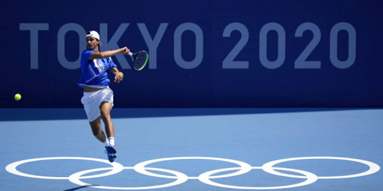 Lorenzo Sonego, of Italy, plays against Taro Daniel, of Japan, during the first round of the tennis competition at the 2020 Summer Olympics, Saturday, July 24, 2021, in Tokyo, Japan. (AP Photo/Seth Wenig)