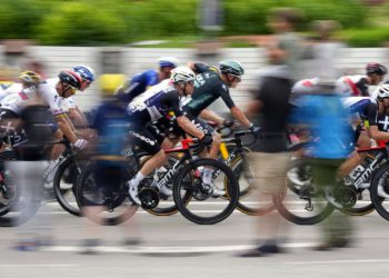 The pack rides during the tenth stage of the Tour de France cycling race over 190.7 kilometers (118.5 miles) with start in Albertville and finish in Valence, France, Tuesday, July 6, 2021. (AP Photo/Christophe Ena)