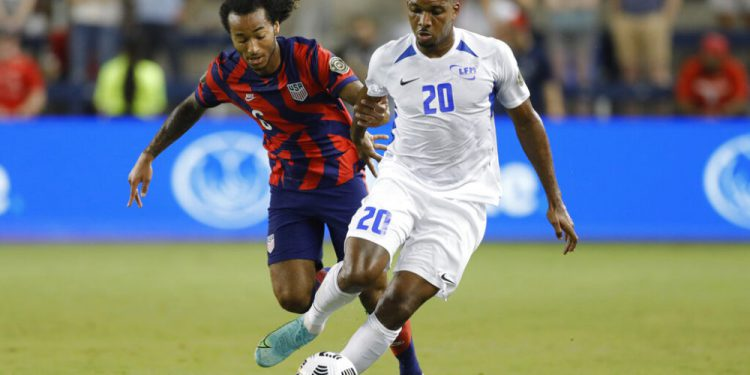 Martinique midfielder Stephane Abaul (20) steals the ball from U.S. midfielder Gianluca Busio during the first half of a CONCACAF Gold Cup soccer match in Kansas City, Kan., Thursday, July 15, 2021. (AP Photo/Colin E. Braley)