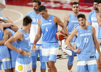Argentina's Luis Scola (4) walks off the court with teammates at the end of a men's basketball quarterfinal round game against Australia at the 2020 Summer Olympics, Tuesday, Aug. 3, 2021, in Saitama, Japan. (AP Photo/Charlie Neibergall)