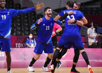 France's team players celebrate as they won the men's gold medal handball match between France and Denmark at the 2020 Summer Olympics, Saturday, Aug. 7, 2021, in Tokyo, Japan. (AP Photo/Pavel Golovkin)