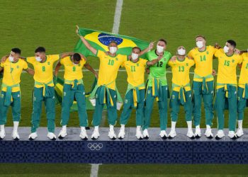 Players of Brazil celebrate on the podium after defeating Spain in the men's soccer final match at the 2020 Summer Olympics, Sunday, Aug. 8, 2021, in Yokohama, Japan. (AP Photo/Martin Mejia)
