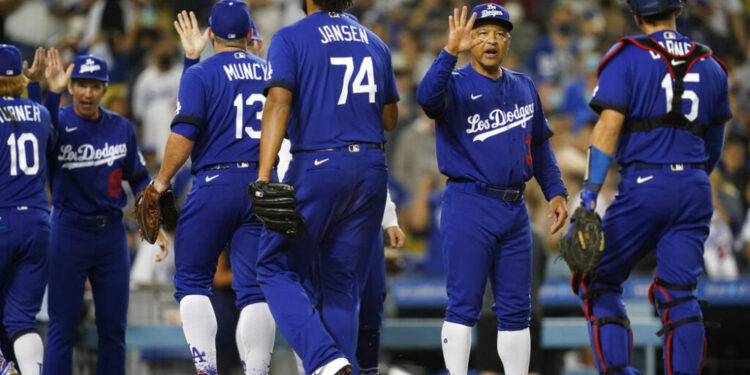 The Los Angeles Dodgers celebrate after a 3-2 win over the New York Mets in a baseball game Friday, Aug. 20, 2021, in Los Angeles. (AP Photo/Ashley Landis)