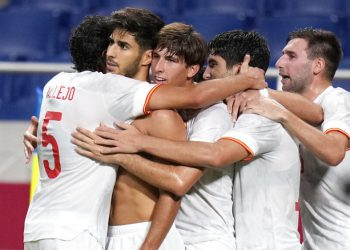 Spain's Marco Asensio, second left, celebrates scoring the winning goal against Japan with teammates during a men's semifinal soccer match at the 2020 Summer Olympics, Tuesday, Aug. 3, 2021, in Kashima, Japan. (AP Photo/Silvia Izquierdo)