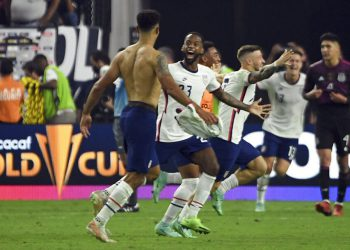 United States midfielder Kellyn Acosta (23) celebrates with defender Miles Robinson after their extra-time victory over Mexico in the CONCACAF Gold Cup final soccer match Sunday, Aug. 1, 2021, in Las Vegas. (AP Photo/David Becker)