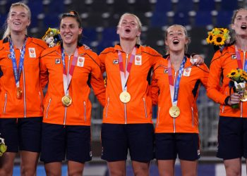 Netherlands players sing their national anthem during the medal ceremony after beating Argentina 3-1 in the women's gold medal field hockey match during the 2020 Summer Olympics, Friday, Aug. 6, 2021, in Tokyo, Japan. (AP Photo/John Locher)