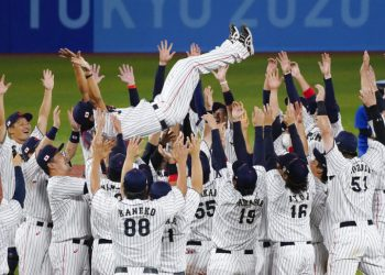 Team Japan tosses their manager Atsunori Inaba as they celebrate after the gold medal baseball game against the United States at the 2020 Summer Olympics, Saturday, Aug. 7, 2021, in Yokohama, Japan. Japan won 2-0. (AP Photo/Jae C. Hong)