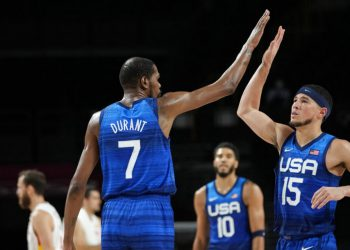 United States' Kevin Durant (7) celebrates with teammate United States' Devin Booker (15) during men's basketball quarterfinal game against Spain at the 2020 Summer Olympics, Tuesday, Aug. 3, 2021, in Saitama, Japan. (AP Photo/Eric Gay)