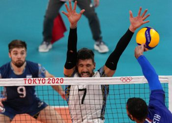 France's Earvin Ngapeth hits a ball against Argentina's Facundo Conte, during a men's volleyball semifinal match, at the 2020 Summer Olympics, Thursday, Aug. 5, 2021, in Tokyo, Japan. (AP Photo/Frank Augstein)
